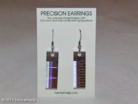 Precision earrings made from tiny, precise straightedges with 0.01-inch and 0.02-centimeter graduations