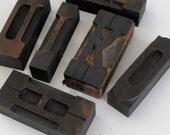Six vintage printer's letterpress type blocks, letters H, K, L, D, I, O