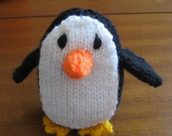 Cuddly hand-knitted penguin.