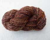 100g Hank of Hand Spun Art Yarn in Purples, Orange and Natural Fleece.
