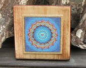 mandala in blue color little picture on old wood