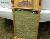 Gilded antique mirror with mythical scene