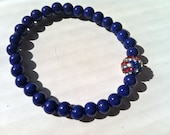red, whit and blue beaded bracelet