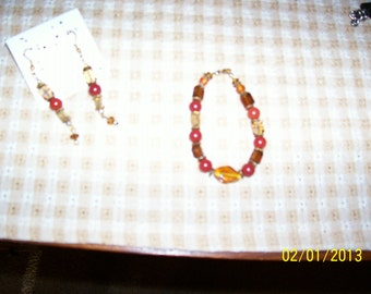 Bracelet & earrings, red, browns, yellows