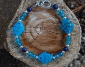 School of Swimming Glass Fish Bracelet - 9 inches