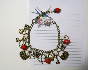 Heart bracelet. Valentines Day. Be mine. Antiqued bronze heart charms and hand wrapped red beads. Adjustable.