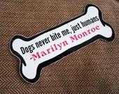 Dogs never bite me magnet