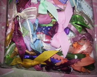 100 Pre-tied bows, Free Shipping, beautiful addition to scrapbooks, glue and decorate hair bows w/them.