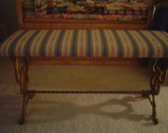 1920s cast iron bench with ornate scrolls