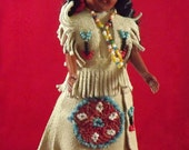 Vintage 1950's Carlson Souvenir Doll with handstitched beaded suede clothing