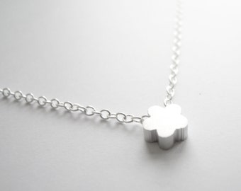Silver necklace with tiny flower bead pendant