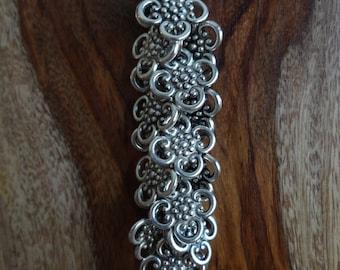 "the ""quatrefoil in filigree"" keychain"
