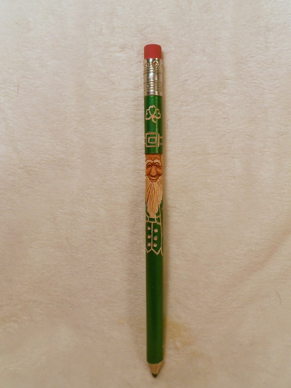 Items similar to hand carved leprechaun pencil with