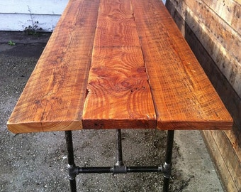 Barn-Wood Dining Table with Cast-Iron Legs.