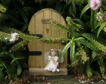 Fairy Door with a fairy sitting on the step