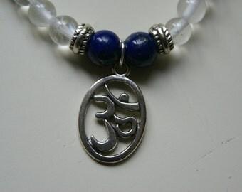 Clear Quartz Bracelet with Lapis Lazuli  Beads and Tibetan Silver Om Symbol Charm