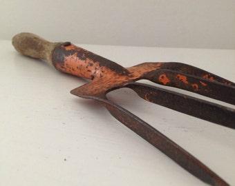 vintage chippy orange garden fork