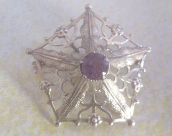 Large silver and amethyst brooch
