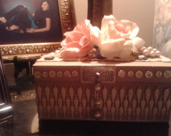 Decorated Hat box, decorated with vintage lace,jewelry,flowers and buttons. One of a kind