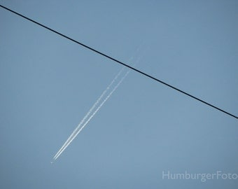 Lines.  Art photography, Germany, telephone line, airplane contrail, blue sky