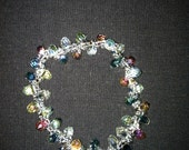 Clear beaded bracelet accented with silver