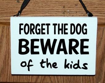 Forget the dog beware of the kids wood sign - door hanger, wall hanging