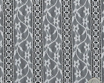 ribbon dancers black stretch lace fabric by the yard table