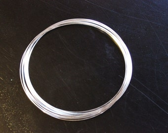 one continuous roll of memory wire used for making choker style necklaces, 11.5 cm in diameter, 0.6 mm wire, makes about 10 circles, silver