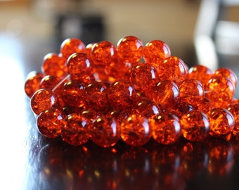80 approx. orange 10mm crackle glass beads, 1.5mm hole