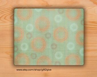 Mousepad Orange and White Circlular Design Faded Green Background