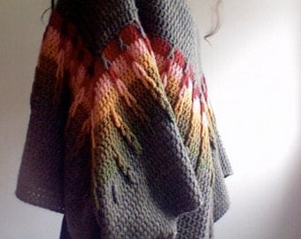 Handmade Poncho: with looping detail and tasseled corners.