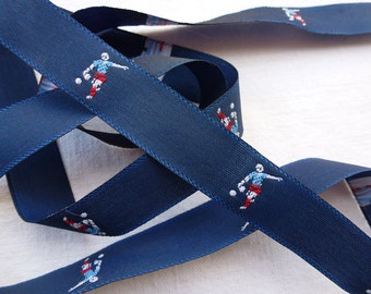 Soccer player, footballer, sports person woven ribbon, blue trim