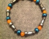 Hematite and beads. Fits most wrists. (Male)