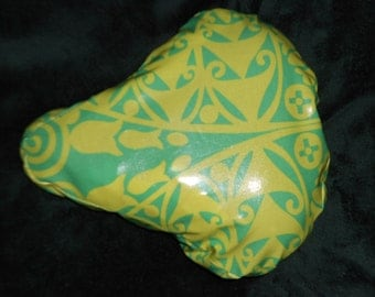 Premium Laminated cotton, waterproof cruiser bike seat cover Amy Butler design, temple doors, in green and yellow