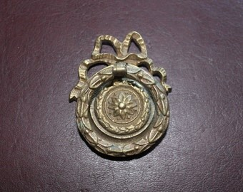 Intricate solid brass ring pull