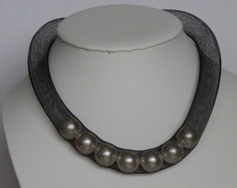 Black mesh tube necklace with 16mm pearls inside