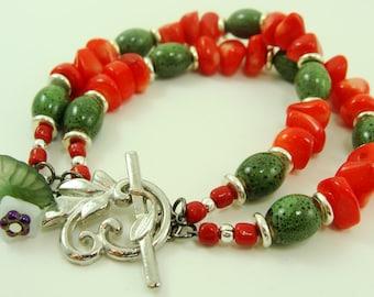 Salsa Verde bracelet of coral and porcelain beads are a reminder of summer days