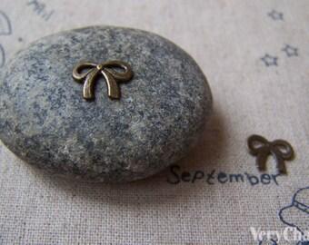 SALE Tiny Bow Tie Charms Antique Bronze Bowtie Charms 8x10mm  Set of 50 pcs   A5008