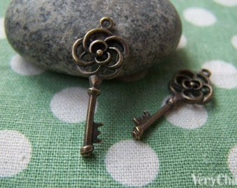 10 pcs of Antique Bronze Filigree Flower Key Charms 11x28mm A184