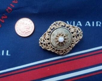 Diamond shaped goldtone filigree and faux pearl brooch