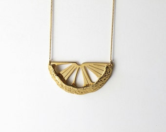 """Necklace """"Citrus metal"""" representing half a lemon with its bark, gilded in 24-carat gold"""