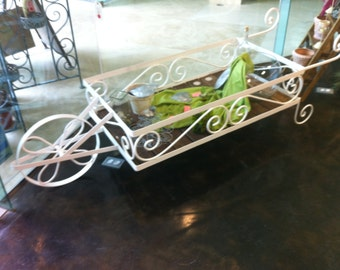 Beautiful, wrought iron hand made and forged, Wheelbarrow, a very useful and decorative item for your garden or home.