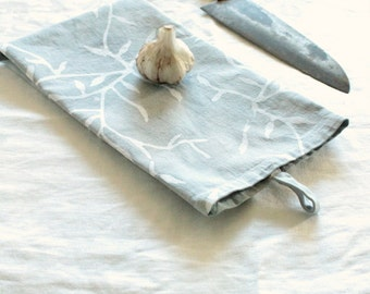 cotton tea towel with a tab. mist gray vines