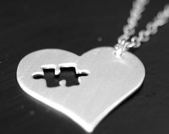 Argentium silver Heart necklace with puzzle Piece removed.