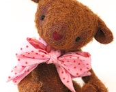 Poppy the jointed teddy bear with pink bow