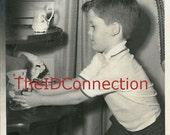 Vintage Black & White Christmas Photograph, My Favorite Christmas Ornament, Placing carefully on desk.  Santa, Kris Kringle