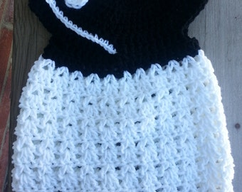 Crochet baby girl dress 0 to 3 mo. button closure flap at neck.