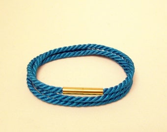 Turquoise blue triple wrap rope bracelet with gold magnetic clasp