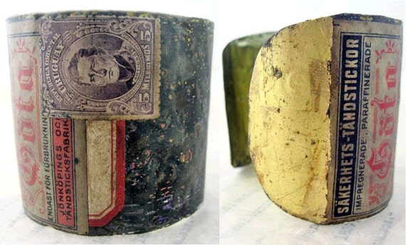Melancholia. Recycled Rustic Tea Tin Cuff with Gold Leaf.