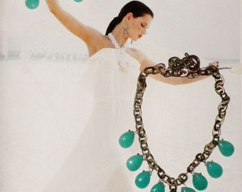 Amazonite teal tear drop charms on a chunky, statement bib necklace with turquoise Swarovski crystals